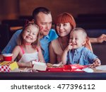 happy family eating fast food... | Shutterstock . vector #477396112