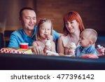 happy family eating ice cream... | Shutterstock . vector #477396142