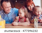 happy family eating fast food... | Shutterstock . vector #477396232