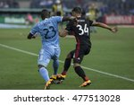 Small photo of New York, NY USA - September 1, 2016: Jefferson Mena (23) of NYC FC & Luke Mishu (34) of DC United fight for ball during MLS game at Yankees stadium NYC FC won 3 - 2