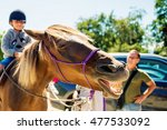 laughing horse with big yellow... | Shutterstock . vector #477533092