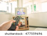 watching tv and using remote... | Shutterstock . vector #477559696