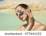 woman with black clay facial... | Shutterstock . vector #477641152