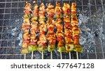 pork barbeque on a hot fire | Shutterstock . vector #477647128