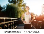 sporty woman living a healthy... | Shutterstock . vector #477649066