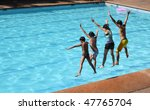 asian friends jumping on the swimming pool - stock photo