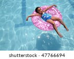 little asian child relaxing on the pool - stock photo