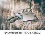 house key on a house shaped... | Shutterstock . vector #477672532