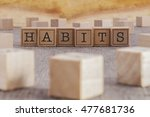 Small photo of HABITS word written on building blocks concept
