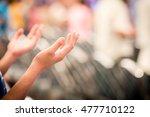 Hands Raised Like Praying Or...