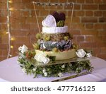 tiered cheese wedding cake | Shutterstock . vector #477716125