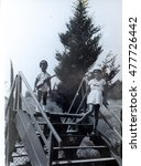 Small photo of USSR, ABKHAZIA, LESELIDZE - CIRCA 1978: Vintage photo of children on a wooden ladder