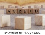 Small photo of AGREED word written on building blocks concept