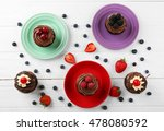 delicious cupcakes on colorful...