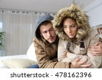 cold home with an angry couple...