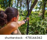 Woman Practices Archery In The...