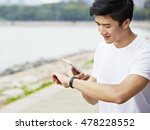 young asian man using apps in... | Shutterstock . vector #478228552