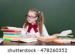 young girl reading a book near... | Shutterstock . vector #478260352
