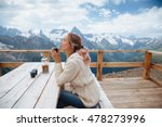 Woman Drinking Warm Tea In The...