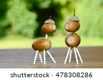 Acorn Figure Standing On Wood