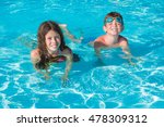 two kids playing in water | Shutterstock . vector #478309312