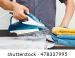 man irons clothes on ironing... | Shutterstock . vector #478337995