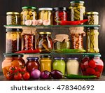 Small photo of Jars with variety of pickled vegetables. Preserved food