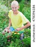 boy near the beds of pepper in... | Shutterstock . vector #478396186