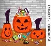 three halloween pumpkins on the ... | Shutterstock .eps vector #478554835