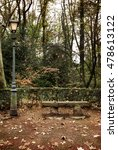 Small photo of Bench and lamppost at park.Autumnal ambiance.