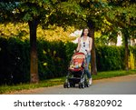 mother with baby carriage in... | Shutterstock . vector #478820902