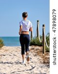 young woman jogging on the beach   Shutterstock . vector #47898079