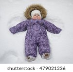 Small Baby Girl In The Snow