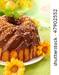 chocolate ring cake with nuts for easter - stock photo