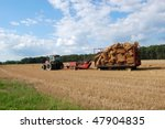 A Red Tractor Pulling A Wagon...