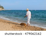 Senior Man With Dog In White...