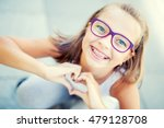 smiling little girl with braces ... | Shutterstock . vector #479128708