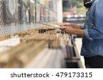 Man Browsing Vinyl Album In A...