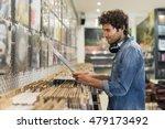 man browsing vinyl album in a... | Shutterstock . vector #479173492