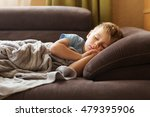 the sad kid lies on a sofa in... | Shutterstock . vector #479395906