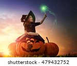 Stock photo happy halloween cute cheerful little witch with a magic wand and book of spells beautiful child 479432752
