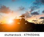 Silhouette Farmer In Tractor...
