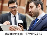 two businessmen talking outdoors | Shutterstock . vector #479542942
