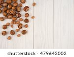 hazelnuts on a old wooden table....   Shutterstock . vector #479642002