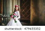 beautiful bride near old big... | Shutterstock . vector #479655352