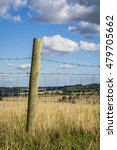 A Single Wooden Fence Post And...