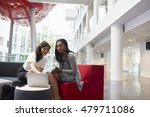 two businesswomen using laptop... | Shutterstock . vector #479711086