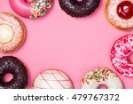 donuts with icing on pastel... | Shutterstock . vector #479767372