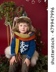 Small photo of Happy Christmas Child in winter hat: Holiday, x-mas setting