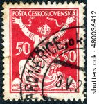 Small photo of CZECHOSLOVAKIA - CIRCA 1920: Postage stamp printed in Czechoslovakia, shows the Allegory of Republic, Breaking Chains to Freedom, circa 1920
